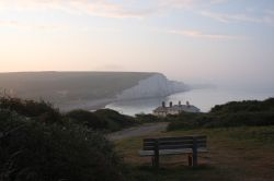 Sunrise over a bench in front of the coastguard houses