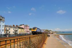 Dawlish promenade with first Intercity 125 heading out of Dawlish - June 2009