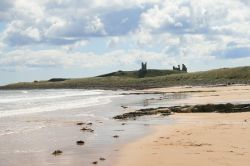A view of Dunstanburgh Castle from the beach