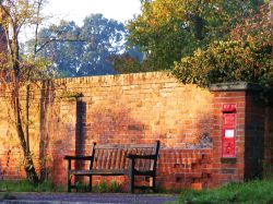 Bench, letter box, dawn.
