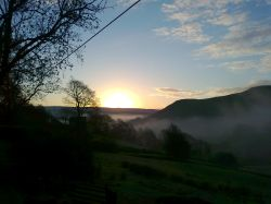 Mist rising over Delph