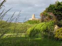 Glimpse of Bamburgh Castle
