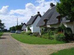 Row of Cottages overlooking green