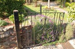 Cockington village in Devon  The iron gate