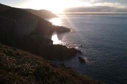 Morning sunrise above Manorbier Bay.