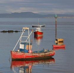Small boats at high tide, Morecambe, Lancashire