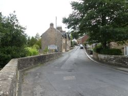 This Picture depicts a sign in Gilsland Village with Northumberland the other half of the village is in Cumbria