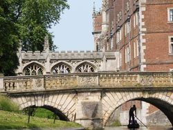 Punting under a bridge, on the River Cam in Cambridge