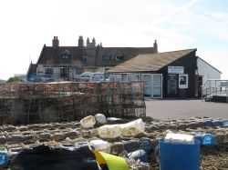 The fish stall and workers housing at Mudeford Quay, Dorset