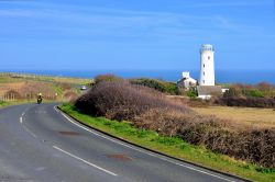 Motorbike Passing the Old Lower Light at Portland Bill in Dorset