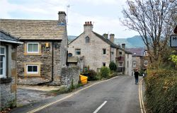 View Down Hollowford Road in Castleton, with Typical Stone Cottages & the Ramblers Rest pub
