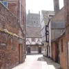 A view of Tewkesbury Abbey from with a street in the town of Tewkesbury.