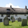 Traditional Devon cottages backing onto churchyard in Zeal Monachorum, Devon