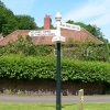 A sign post in the village of Holford on the edge of the Quantock hills in somerset