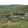 One of the huts at the Bronze-Age village of Grimspound, on Dartmoor -