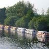 Boats Lined up along the River Bure at Wroxham, Norfolk
