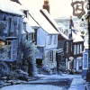 Painting of Mermaid Street, Rye, in the snow by Colin Bailey