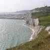 The white cliffs of Dover, Kent, Dover harbour, and on top of the hill, the coastguard station.