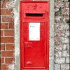 Wall mounted, and much repainted Edward VII Postbox, Upper Row, Dunham-on-Trent, Nottinghamshire