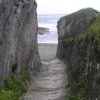 Rock-cut path to the beach at Lansallos cove in Cornwall