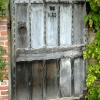 An old door (1680) in the garden wall at Kedleston Hall, Derbyshire