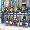Cheerful, flower-bedecked pub, London