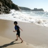 My son enjoying the waves at Porthcurno