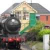 Sheringham Station, steam train passing the signal box