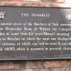 A sign outlining the history of The Shambles, York