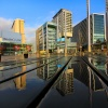 Media City, Salford Quays, a reflection on a picnic bench.