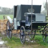 Horse carriage on farm land near village of Laxfield Suffolk