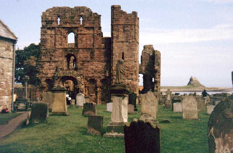 The ruins of Lindisfarne Abbey with Lindisfarne Castle in the distance.